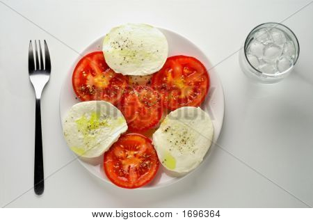 Caprese Salad With Water Glass - High Angle View