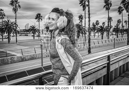 Woman On Embankment In Barcelona, Spain Looking Into Distance