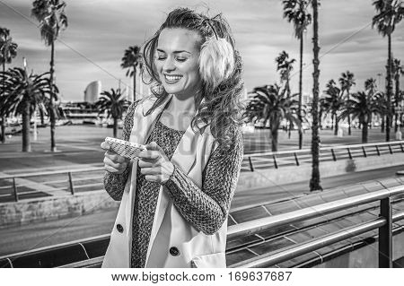 Traveller Woman On Embankment In Barcelona, Spain Writing Sms
