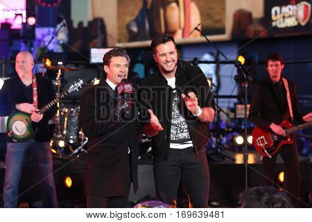 NEW YORK-DEC 31: Recording artist Luke Bryan (R) and host Ryan Seacrest onstage during Dick Clark's New Year's Rockin' Eve at Times Square on December 31, 2015 in New York City.