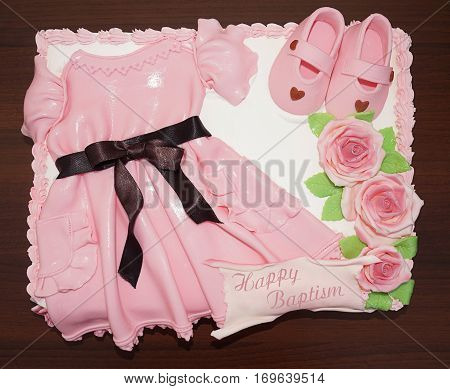 Pink dress cake with shoes and flowers christening and baptism