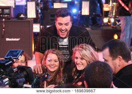 NEW YORK-DEC 31: Recording artist Luke Bryan poses with fans during Dick Clark's New Year's Rockin' Eve at Times Square on December 31, 2015 in New York City.