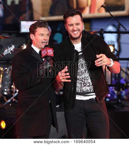 NEW YORK-DEC 31: Recording artist Luke Bryan (R) and Ryan Seacrest onstage during Dick Clark's New Year's Rockin' Eve at Times Square on December 31, 2015 in New York City.