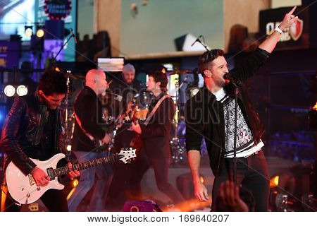 NEW YORK-DEC 31: Recording artist Luke Bryan (R) performs during Dick Clark's New Year's Rockin' Eve at Times Square on December 31, 2015 in New York City.