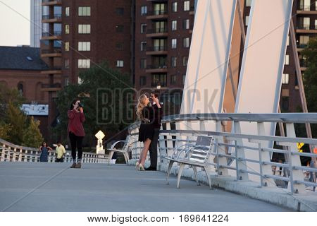 COLUMBUS, OHIO - OCTOBER 22, 2016:  A Photographer captures a couple in love on the Main Street Bridge in Columbus, Ohio.