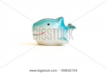 The Miniature isolated toy whale.