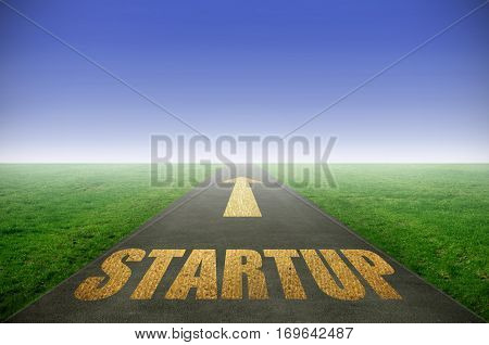Startup gold printed on road leading towards horizon