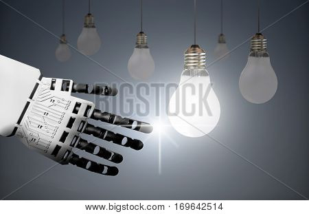 Technology leader concept, robot hand touching a lit bulb creating a spark