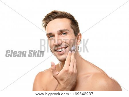 Skin care concept. Young man applying shaving foam, white background