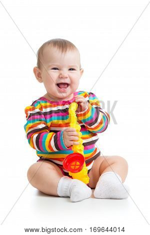Funny baby girl with musical toy isolated on white