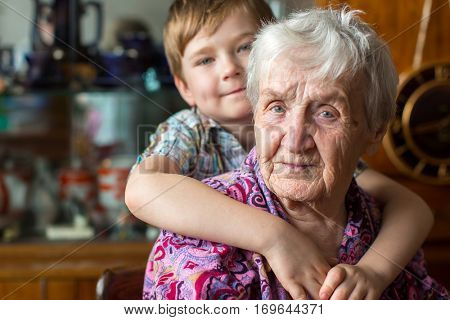 Grandmother with a small boy grandson.