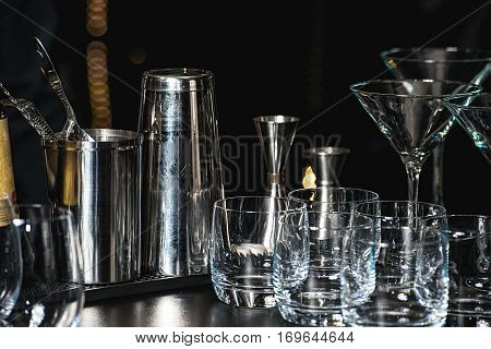 Glasses For A Margarita, Martini, Grog And Liqueur On A Bar At Restaurant, Against The Bar Bar Wall