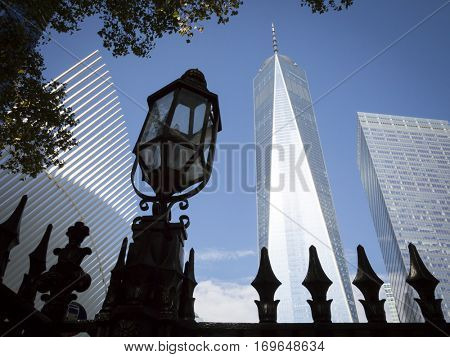 NEW YORK - SEPT 11 2016: Lamp posts on the wrought iron fence around St Pauls Chapel at Ground Zero with the Freedom Tower behind in Lower Manhattan on the 15th anniversary of the 9/11 terror attacks.