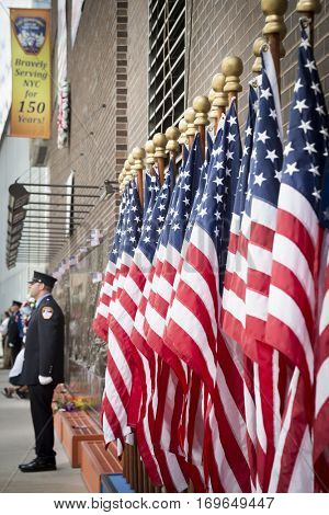 NEW YORK - SEPT 11 2016: American Flags line the entrance of the FDNY Ten House fire station in Lower Manhattan on the 15th anniversary of the terror attacks at the World Trade Center.