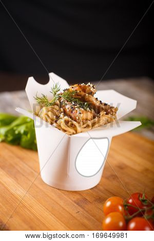 Wok Noodles With Chicken In Paper Packaging