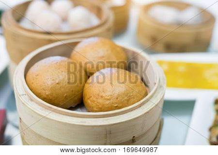 brown sugar steamed breads in bamboo steam containers.