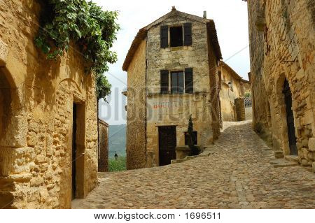 Bakery at the intersection of two cobblestone streets in an old French mountain village. poster