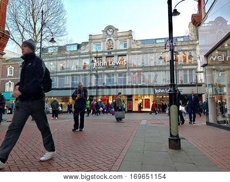 READING - DECEMBER 29: Pedestrians walks along Broad Street outside the John Lewis Department Store on December 29, 2016 in Reading, Berkshire, UK.