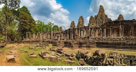 Prasat Bayon with smiling stone faces is the central temple of Angkor Thom Complex, Siem Reap, Cambodia. Ancient Khmer architecture and famous Cambodian landmark, World Heritage.