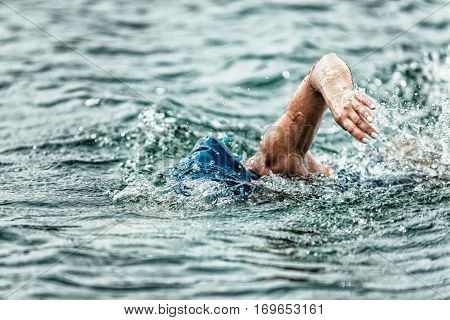 Triathlon long distance swimming, toned image, horizontal