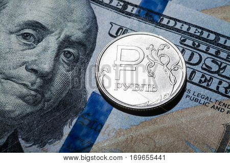 One ruble coin on dollar banknote. Closeup, macro shot