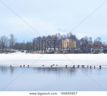View of Neva River and Lutheran Church of St. Catherine on the outskirts of St. Petersburg at cloud winter day Russia.