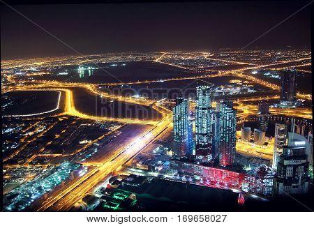 DUBAI UAE - JANUARY 28: Top view of the coast in Dubai at night on January 28 2017 Dubai UAE.