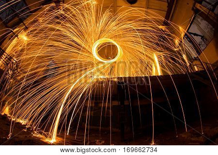 Freezelight using spinning burning steel wool and pyrotechnics in abandoned factory