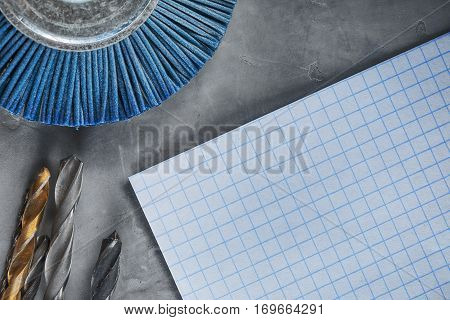 Workplace On A Concrete With Paper Drill Bit, Tools, Grinding Discs