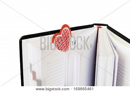 Bookmark in a notebook for Valentine's Day isolated on white