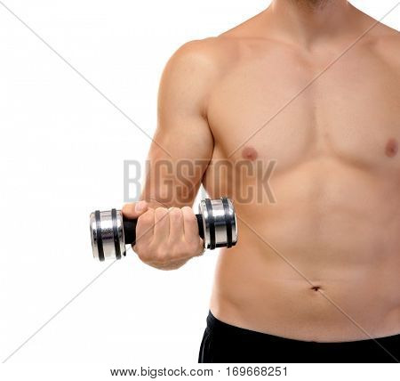 Young man doing exercises with dumb-bells indoors