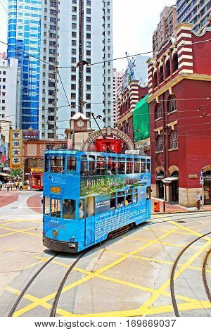 HONG KONG - MAY 15, 2014: Unidentified people using city tram in Hong Kong. Tram in Hong Kong is the only tram system in the world run with double deckers