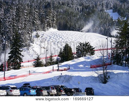 WHISTLER, BC,CANADA - February 7, 2017 : Snow blowers making snow on Blackcomb Mountain. Whistler, BC, Canada, February 7, 2017