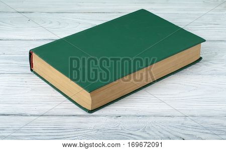 Green book on wooden table.Education background.Back to school.