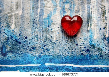 Red Glass Heart on painted blue background