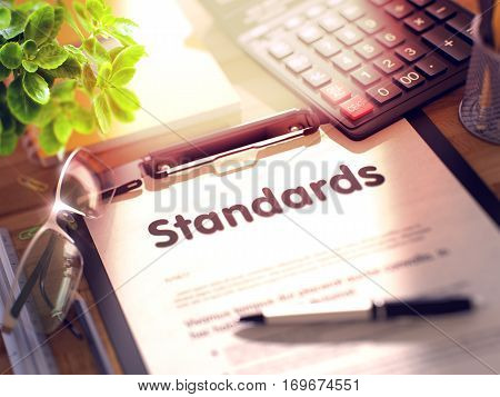 Standards on Clipboard with Paper Sheet on Table with Office Supplies Around. 3d Rendering. Blurred Toned Illustration.