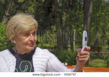 Senior Woman With Camera Phone