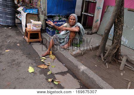 KOLKATA, INDIA - FEBRUARY 09: Beggars in front of Sree Sree Chanua Probhu Temple in Kolkata, West Bengal, India on February 09, 2016.