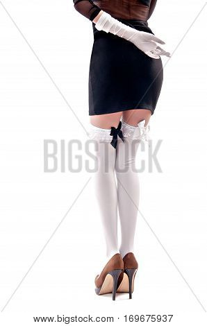 woman in black dress and white stockings on an isolated background