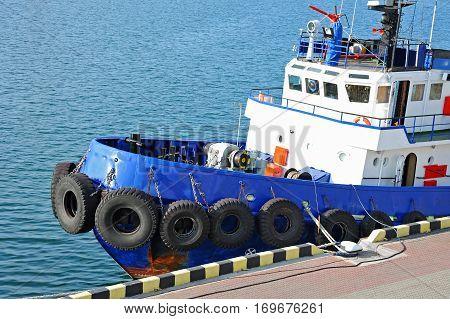 Tugboat in harbor quayside on Odessa Ukraine