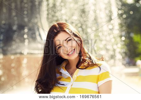 portrait of a beautiful smiling woman in a summer park. elegance casual model outdoors
