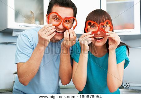 young cheerful couple cook together in the kitchen. healthy eating