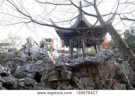 XITANG - FEBRUARY 20: Pagoda in Xitang Ming and Qing Dynasty Residence Wood Carving Exhibition Hall, Xitang town in Zhejiang Province, China, February 20, 2016.