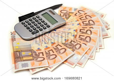 50 euro notes fan-shaped with hand calculator and pen on white background