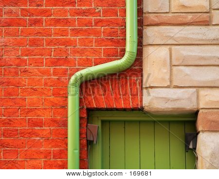 Brick Wall And Rain Gutter