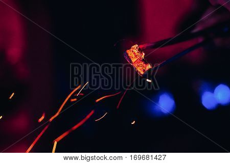 hot coals and red sparks for Shisha with blurred background
