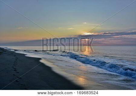 Spectacular Summer Sunrise at the Shore in Early Morning