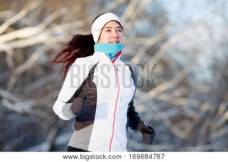 Young brunette engaged in running