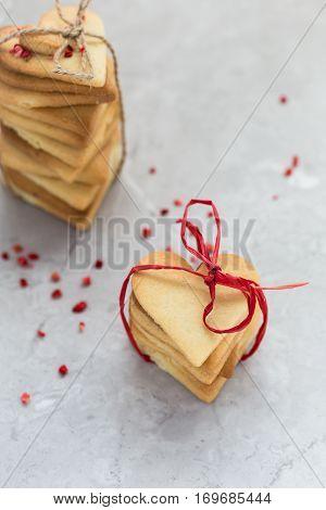 Stacks of Homemade Heart Shaped Biscuits Tied with String for Valentine's Day Gift
