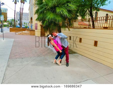 Las Vegas, United States of America - May 07, 2016: Wedding in Las Vegas at small white chapel. The groom holding a bride at Las Vegas, USA on May 07, 2016